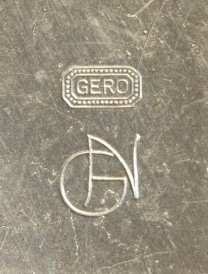Merkteken klassiek Gero tin, theepotje rotan handvat